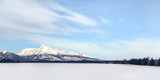 Snow covered field with Mount Krivan (Slovak symbol) in distance. Wide winter panorama with space for text.