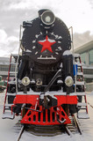 Old vintage Soviet black and red steam locomotive with a star