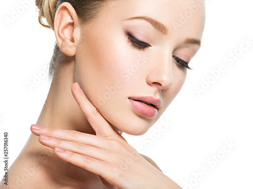 Beautiful face of young woman with perfect health skin © Valua Vitaly