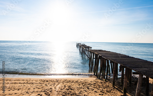 Sea view, blue sky, old wooden bridge, beautiful summer © Waraphot