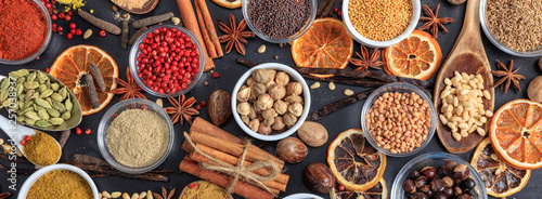 Spices and herbs. Colorful spices flat lay on wooden table © Rawf8