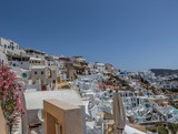 The village of Oia on the Greek island Santorini with numerous white houses nexto to the caldera during summer time, Cyclades