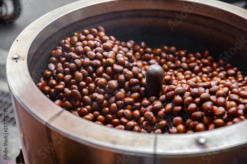 Fototapeten Bangkok Roasting Brown Chestnuts In Big Pot At Local Street Market