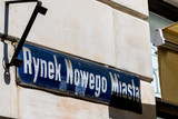 Warsaw, Poland New town historic road during sunny summer day morning with closeup of street sign and text for Rynek Nowego Miasta in Polish