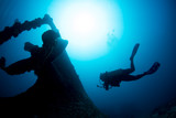 Ship Wreck propeller underwater with scuba diver silhouette