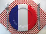French cuisine  or rfrench estaurant concept. Plate with flag of France with knife and fork. - 257172934