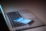 Smartphone on laptop keyboard. Business comunication and internet network concept background. - 257173169