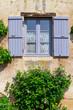 Leinwanddruck Bild - Hausfassade in Burgund