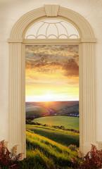 Torbogen mit Blick auf Hügellandschaft bei Sonnenuntergang © SusaZoom