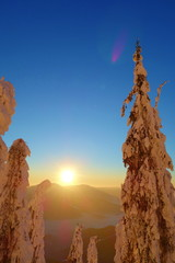 Sunset from a peak of Lysa hora with snowy and frozen trees in Czech Republic © Tom