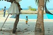 Isolated little boy in the harbor with his father (Ari Atoll, Maldives)