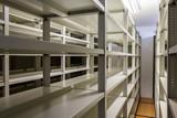 Empty metallic bookshelves with dark background