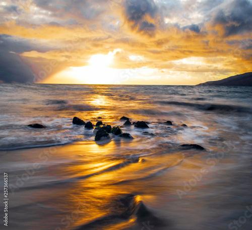 Leinwandbild Motiv Sunset on the Beach with Dramatic Sky in Maui Hawaii
