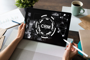 CRM - customer relationship management system concept on screen. © WrightStudio