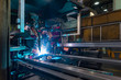 Leinwandbild Motiv The welding robot does the welding of metal spars