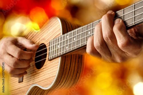 playing a tenor ukulele - 257423549