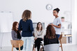 canvas print picture - Group of young women talking sitting in a circle. Psychological support concept