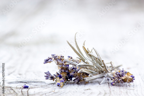 Bunch of dried lavender on old wooden background - 257439532
