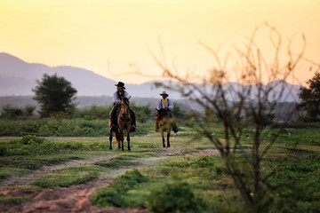 cowboy and horse  at first light,mountain, river and lifestyle with natural light background © chuanchai