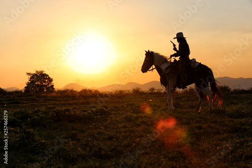 cowboy and horse  at first light,mountain, river and lifestyle with natural sunset light background