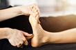 Quadro Woman receiving a thai foot massage at the health spa