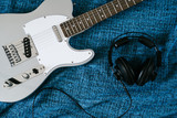Guitar electric and headphones. Rock music background. Top view