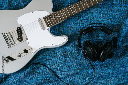 Guitar electric and headphones. Rock music background. Top view - 257502946