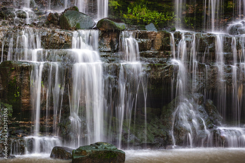 Photo of Waterfall mountain view close up. Mountain river waterfall landscape. © Luis