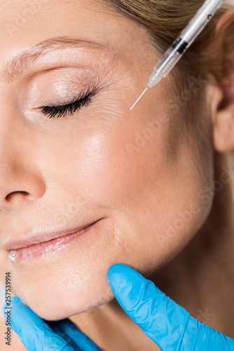 close up of beautiful and mature woman with closed eyes getting beauty injection © LIGHTFIELD STUDIOS