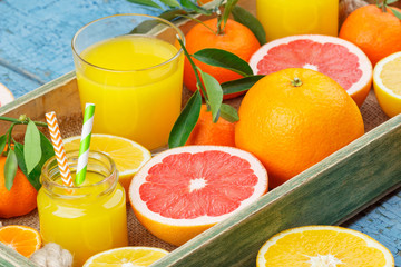 Set of different fruits and glass with fresh orange juice