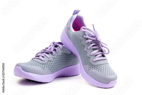 canvas print picture Pair of unbranded purple color sport or running shoes on a white background