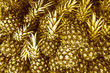 Quadro Gold pineapples background