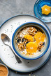 Orange breakfast bowl preparation
