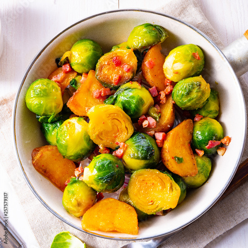 Leinwandbild Motiv Roasted Brussels sprouts with honey and sesame from the oven