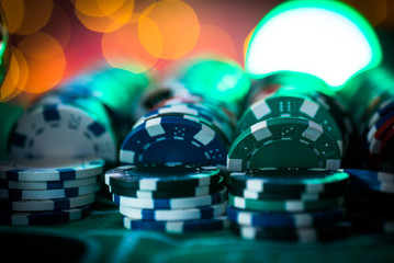 Casino theme. High contrast image of casino roulette, and poker chips © Aerial Mike