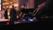 DJ plays vinyl turntables. In a nightclub - bar. The vinyl record is spinning.