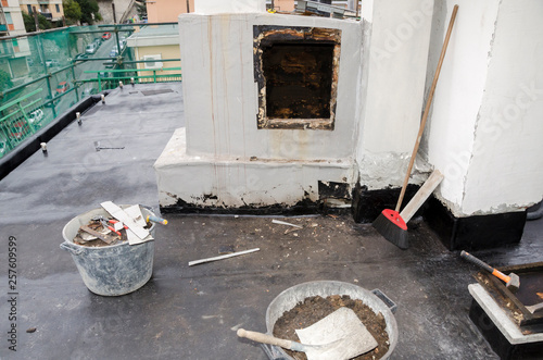 Leinwandbild Motiv construction work during the renovation of a roof of a building with bituminous sheath