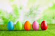 Happy Easter - Colored eggs on grass and green abstract background