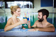 canvas print picture - Happy attractive couple relaxing in swimming pool
