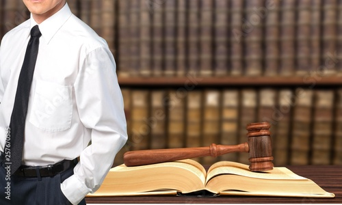 Successful lawyer with book and judge gavel ,Law concept © BillionPhotos.com