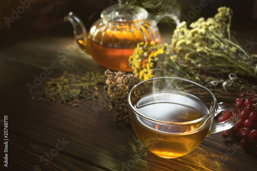 Hot tea in glass teapot and cup on wood © bioraven