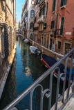 Venice, Veneto, Italy - A view from a bridge in a narrow side canal in Venice on Canale Crande, on a beautiful day in October