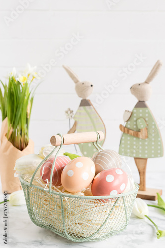 canvas print picture Pastel spring decoration with easter eggs and wooden bunny . Vertical