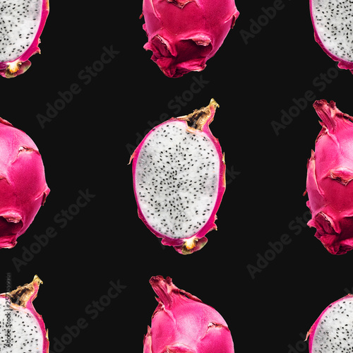 Dragon fruit Seamless pattern Whole and half of pitaya fruits on a black background Bright template for print © Picture Store