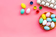 eggs with colorful paint for easter tradition on pink background top view mockup