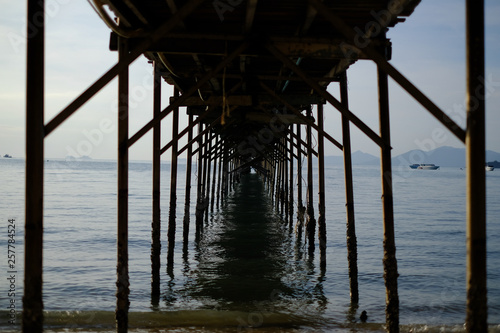 Wooden bridge in the sea © Attapol