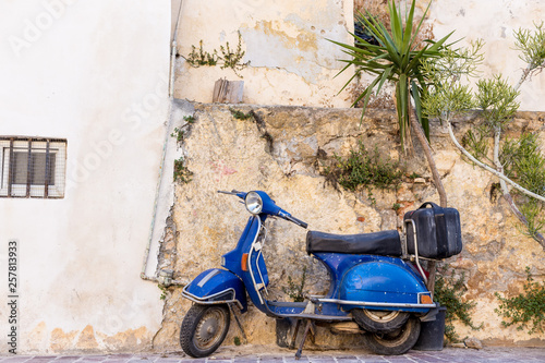 blue old scooter parked by the wall in the empty street Chania Crete © Eduard Zhukov