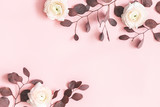 Flowers composition. Pink flowers and eucalyptus leaves on pastel pink background. Flat lay, top view, copy space