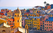 Vernazza village with typical colorful multicolored buildings houses, Castello Doria castle on rock, Ligurian Sea in background, National park Cinque Terre, La Spezia, Liguria, Italy