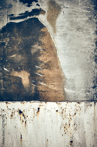 Old rusty stained metal board, toned abstract background or texture. © MaciejBledowski